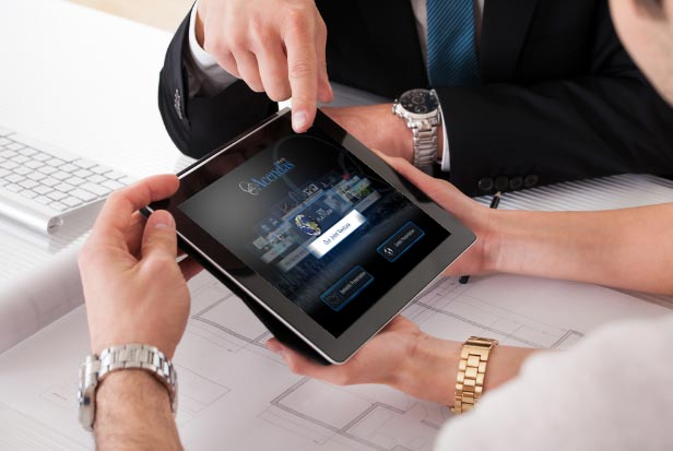 Business people pointing at Acendas App on iPad